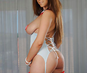 Young and busty brunette babe Sheila B strutting in nurse uniform