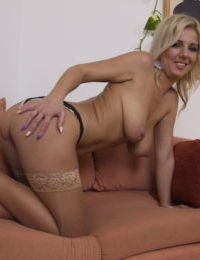 Blonde housewife in flesh colored stockings peels off her clothes