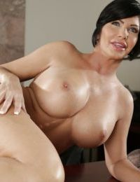 Short haired mature MILF Shay Fox posing for sexy lingerie shoot