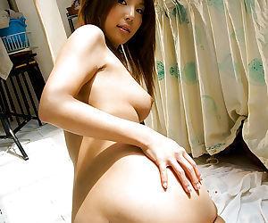 Ravishing asian babe Azumi Harusaki slowly stripping off her clothes