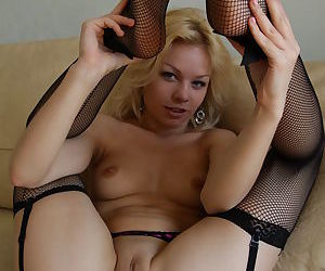Skinny young blonde in nylons Isabella uncovers her bald twat