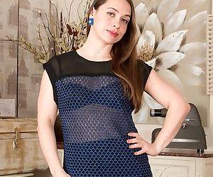 Stocking and garter clad Euro mom Olga Cabaeva revealing hairy cunt