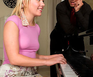 Young blonde Lola Wilde seduces her piano teacher with upskirt panty flash