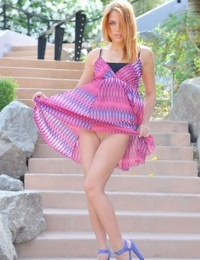 Redhead in short dress flashes no panty upskirt & spreads pussy outdoors