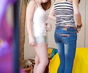 Young amateur girls Bisera and Candice pull on panties after lesbian sex