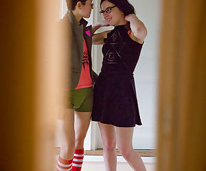 Young dyke girls Twyla and Marietta M dress nerdy bodies after having sex