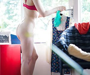 Hidden spy cam records amateur chick Hania dressing her hairy vagina
