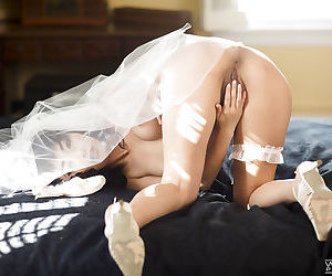 Hot Asian pornstar Marica Hase posing topless in wedding dress
