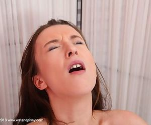 Teen with pretty face Queenie is penetrating her puss with big dildo