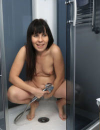 Chubby mature babe with small perky tits masturbates hairy cunt in a shower