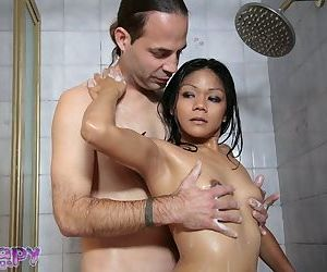 Ravishing Asian babe Krystal holds dick with her soft and tender hands