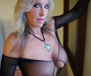Hot older blonde housewife Sandra Otterson modelling mesh lingerie