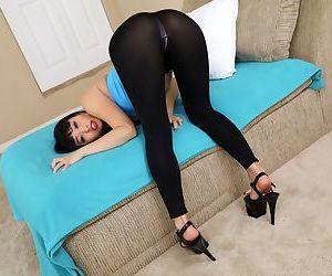 Asian MILF Ayumu Kase slides her spandex pants over thong laden ass
