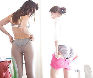 Young chicks Blanca and Gala pull on yoga pants after humping session