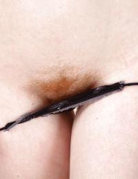 Superb nudity and solo masturbation along hairy amateur Tia Jones