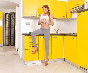 Redheaded teen girl Angella Christen baring young girl tits in kitchen