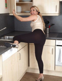 Mature Euro woman Elle Macqueen stripping off spandex pants and panties