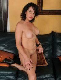 Older mom Braxton Kai flashing shaved MILF vagina and tits