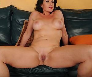 Older mom Braxton Kai flashing shaved MILF vagina and tits