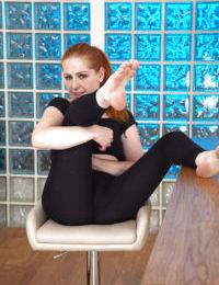 Mature Euro redhead Tia Jones slips off yoga pants to spread hairy snatch