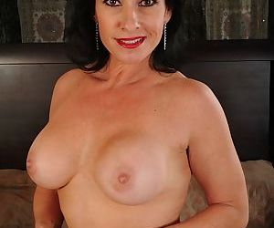 Buxom older lady Braxton Kai exposing large boobs and spreading bald vagina