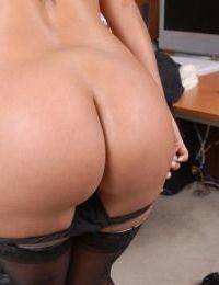 Outstanding secretary Holly Taylor is playing with her trimmed puss