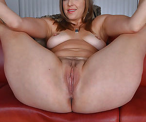 Mature woman Miss MelRose unveiling trimmed vagina and big tits