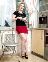 Short haired mature Euro Lisa Young freeing tiny breasts in kitchen