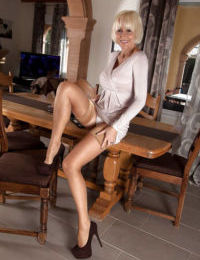 Mature UK dame Jan Burton posing solo in high heels and nylons