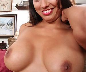 Older Latina lady Abby Melon revealing big natural tits and shaved vagina