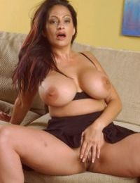 Mature lady whips out huge boobs before exhibiting her fat ass in the nude