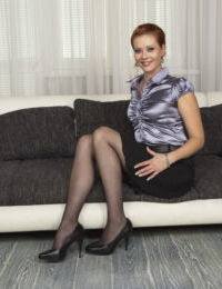 Clothed redhead mom with short hair has her nipples exposed for her on sofa