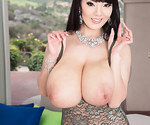 Sexy busty Hitomi strips off her tight skirt & releases her behemoth breasts