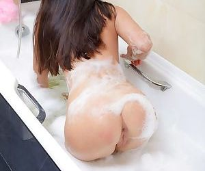 Thin young girl Lotus toys herself to orgasm in the bathroom