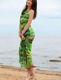 Slender teen Ganna A drops her long dress to air perfect tits on the beach