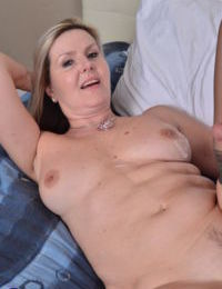 Middle aged woman shows her neighbors boy the ways of sex in her bedroom