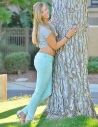Cute teen girl flashes her bare ass under a tree before masturbating at home