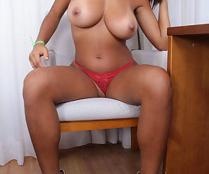 Busty black amateur Yolana showcases her shaved vagina after lingerie removal