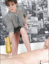 Naughty mature lady in fishnet pantyhose jerking off her human pet cock