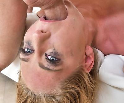 Blonde chick has her makeup run during a gangbang session