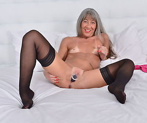 Long haired horny granny looks great in pink with a toy jammed in her old twat