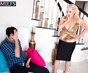 Horny grandma Layla Rose bares her aged tits for some young stud attention