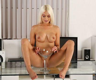 Watersport girl Lena Love wets her pants befoe peeing in a glass & drinking it