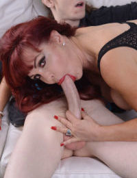 Older redhead Sexy Vanessa seduces a nerdy young boy for a hard fuck