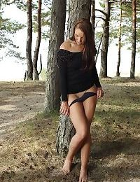 Outdoor undressing action from an amateur teen babe Lorette