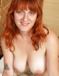 Redhead mature slut with hairy legs and private parts stripping down
