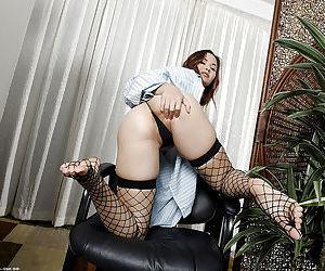 Amateur Asian model Kita Zen posing barefoot in fishnet stockings