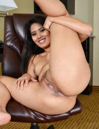 Amateur Japanese brunette Angelina Chung smiles and masturbates