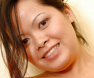 Petite Asian amateur Angela posing in sexy lingerie while flashing pussy