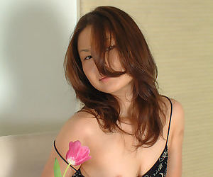 Sweet Oriental amateur Lilianna letting small tits loose from summer dress